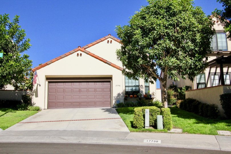 Single story home with brown garage door inside Eastview in Rancho Bernardo CA