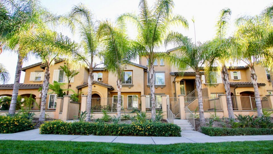 Two story born homes with garages and fences inside Gianni at Rancho Bernardo California