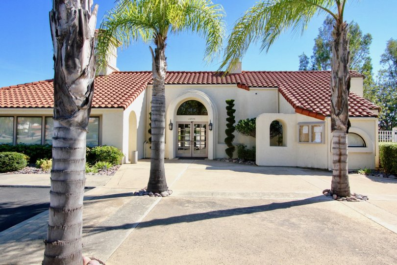 Sunny day at Las Brisas with Palm trees and sand in Rancho Bernardo, California.