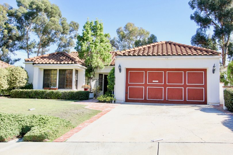 Red garage door on garage near residence at Las Brisas in Rancho Bernardo CA