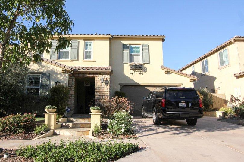 Home with fake gray shutters at Mandolin II in Rancho Bernardo CA