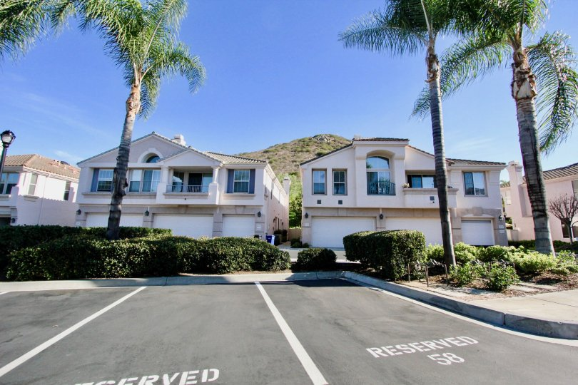 Two story town homes & parking lot inside Mira Lago in Rancho Bernardo CA
