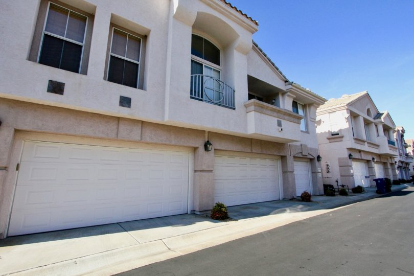 Garages lining a driveway near residence at Mira Lago in Rancho Bernardo California