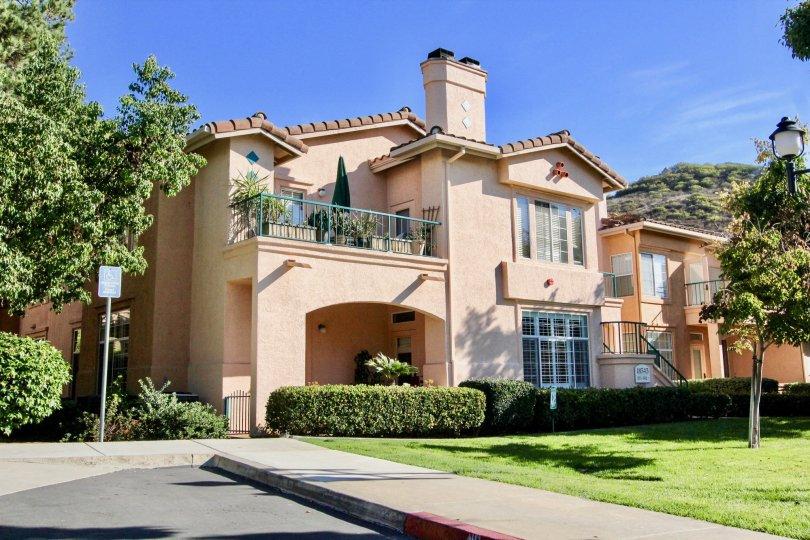 Two story pink condo housing inside Morada in Rancho Bernardo CA