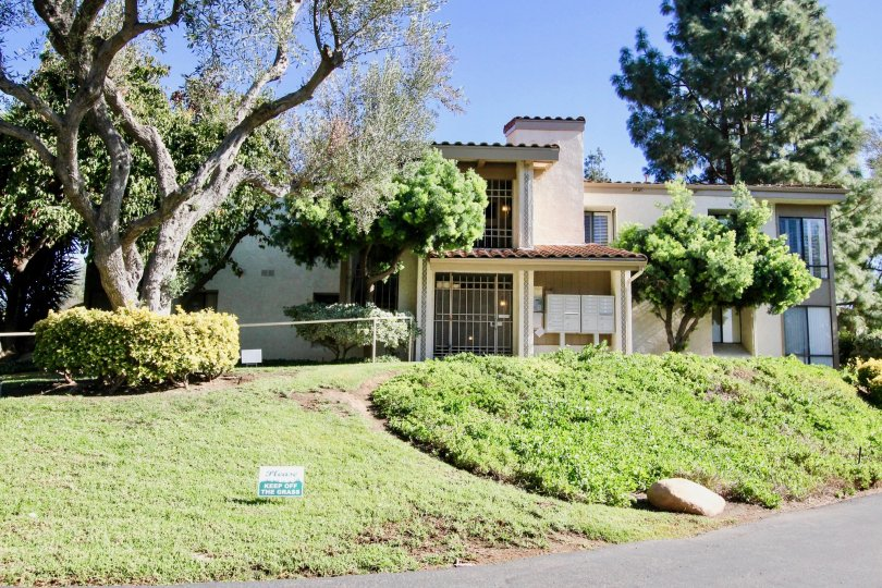 Hillside in front of a residential building at One Oaks North in Rancho Bernardo CA