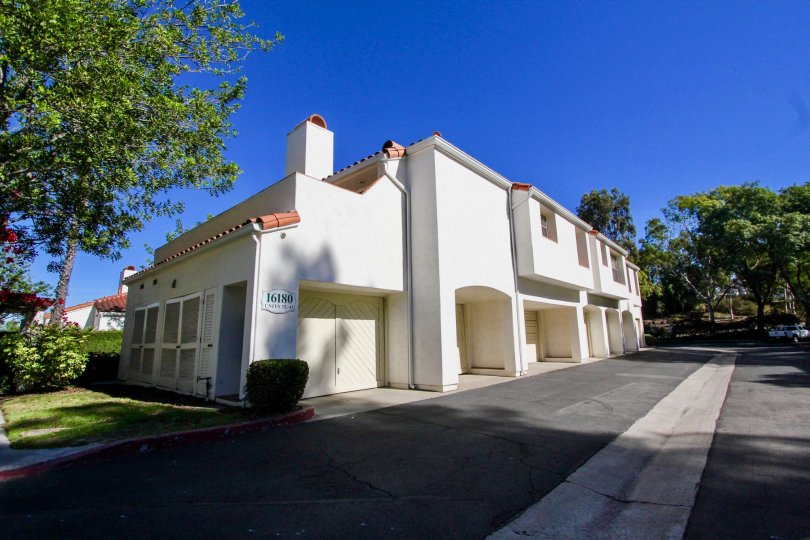 Two story white units with archways inside Palazzo Bernardo in Rancho Bernardo CA
