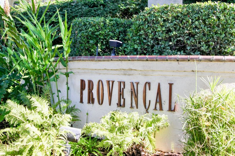 "A sign saying ""Provencial"" surounded with bushes during a sunny day in Provencal, Rancho Bernardo, CA"