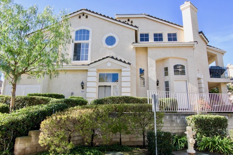 Two story white building with windows & railings at Provencal in Rancho Bernardo California