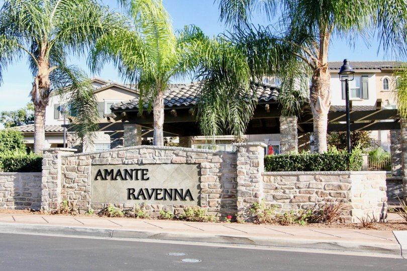 Two story residential units with stone sign near street at Ravenna in Rancho Bernardo CA