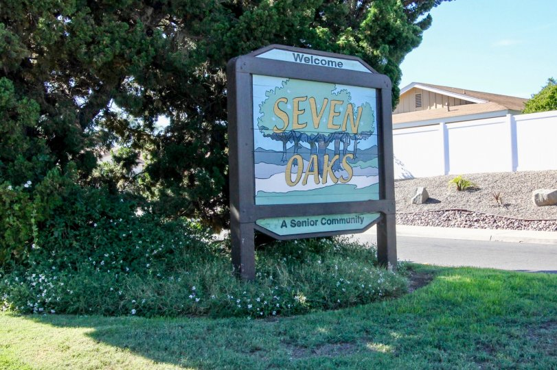 Sign with a pictures of trees in front of Seven Oaks in Rancho Bernardo CA