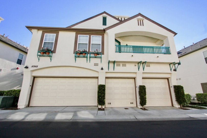 Two story residential building with garages with brown trim inside Sitella in Rancho Bernardo CA