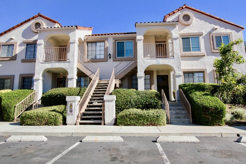 Stony Brook's front view with stairs and shrubs in Rancho Bernardo California.