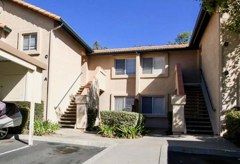 Two stairways attached to a brown residential building at The Falls in Rancho Bernardo California