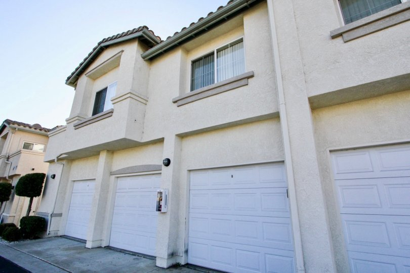 White garage doors on garages attached to units at Vista Del Lago in Rancho Bernardo CA
