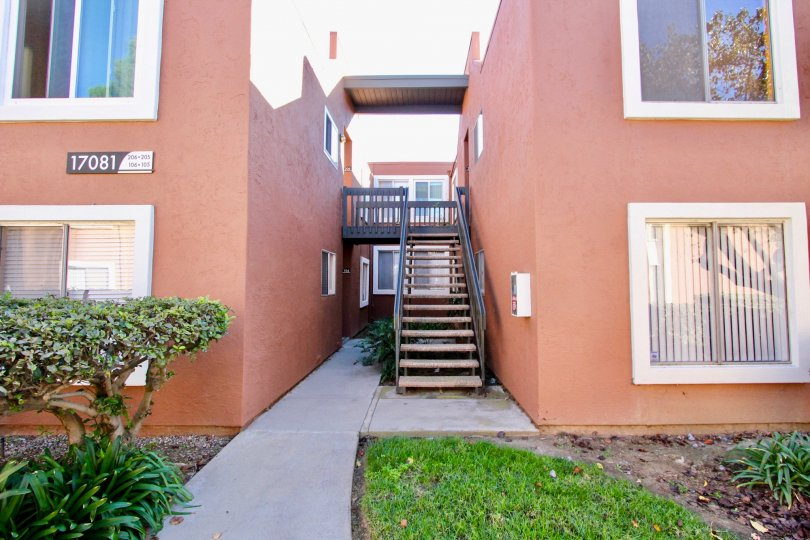 Stairway between pink units inside Waterbridge In Rancho Bernardo CA