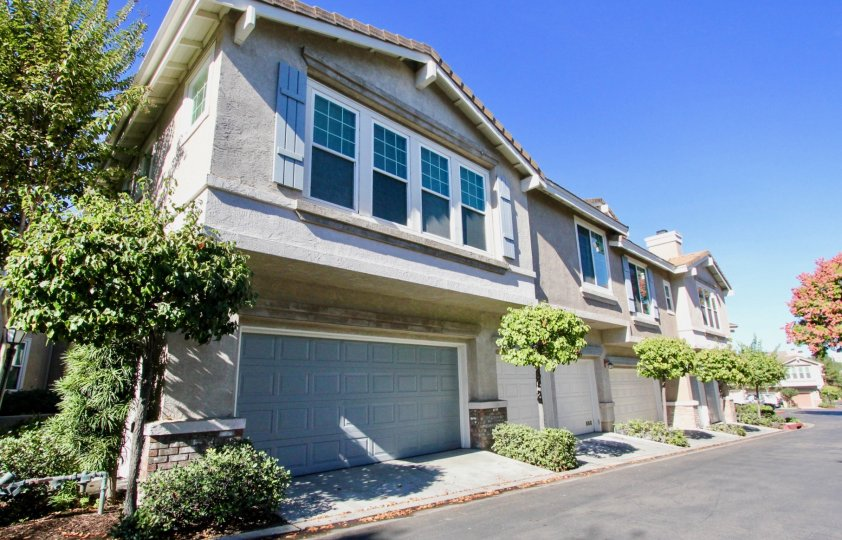 Gray units with a garage door & plants inside Windham in Rancho Bernardo CA