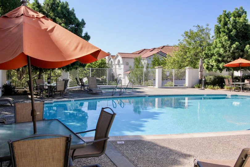 Fabulous swimming pool with sunshine having tent and sitout near villas with trees of Ambiance area of San Marcos