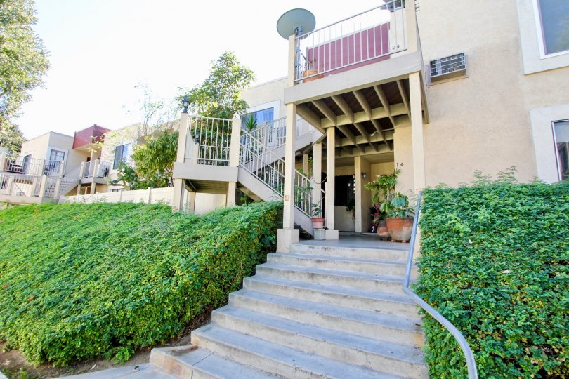 Autumn Heights stairway and beige building with landscaping San Marcos California