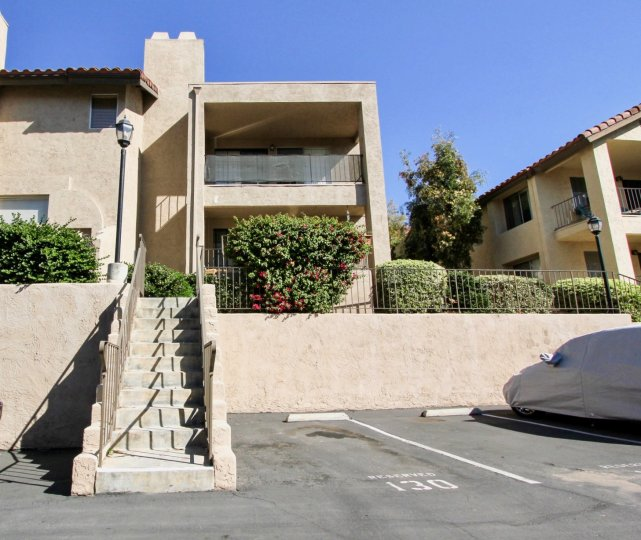 Avocado Gardens beige two-story with stairway San Marcos California