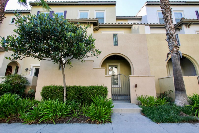 A sunny day in the area of Calico Bluffs, outside, condo, trees, roof, gated entrance