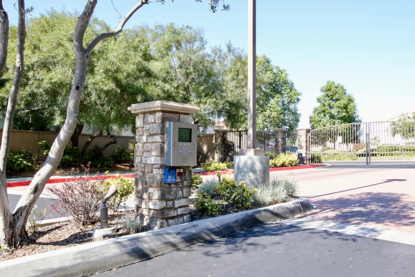 Sunny Day showing the entrance gate intercom of Campana Community in San Marcos, California