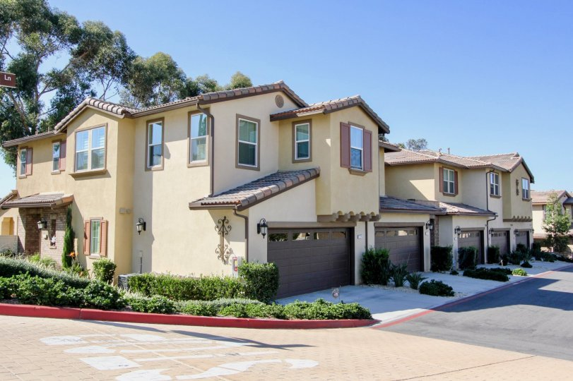 A bright day and a row of homes in the Candera community of San Marcos California