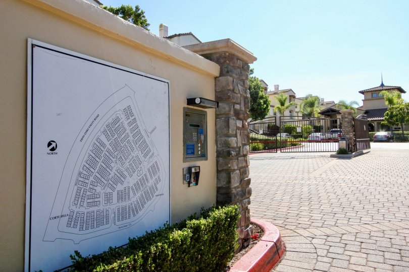 Community map, communication panel and gated entryway on a brick paved road at Coronado Ranch