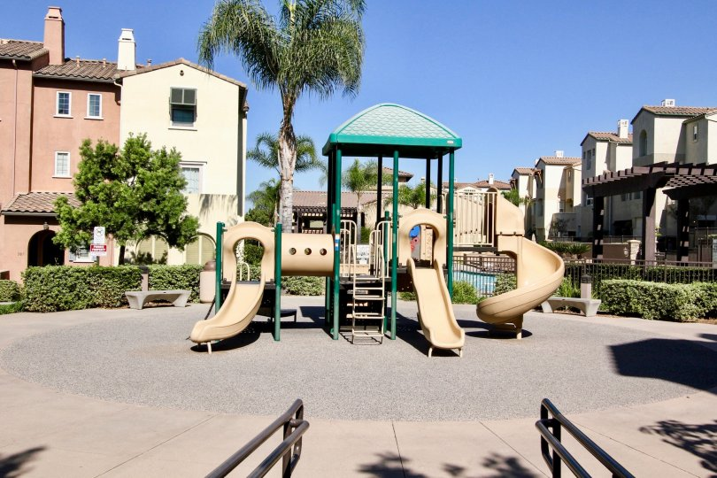 Playground with slides in park like setting at Corte Bella in San Marcos, Ca.
