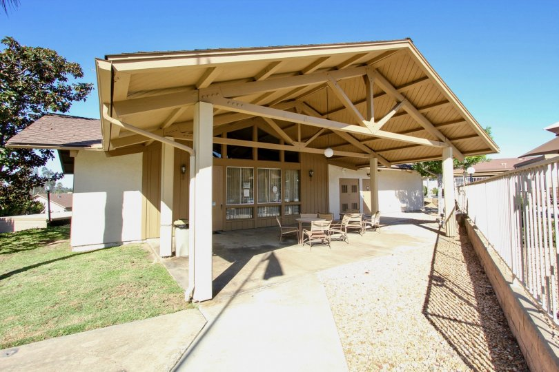 A covered seating area with exposed trusses in the Fairway Knolls community.