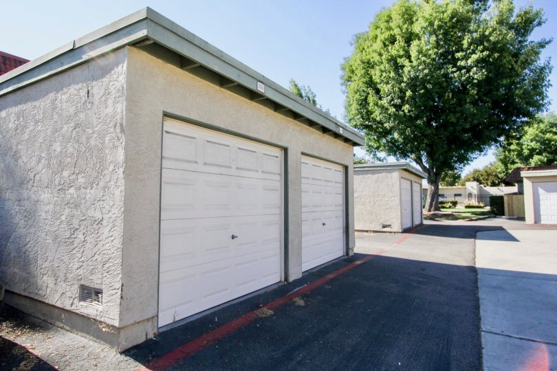 Two garage doors in one building with multiple buildings in Lake Park Terrace community.