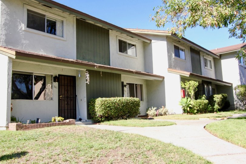 Two story condos in front of sidewalks at Lake Park Villas in San Marcos CA