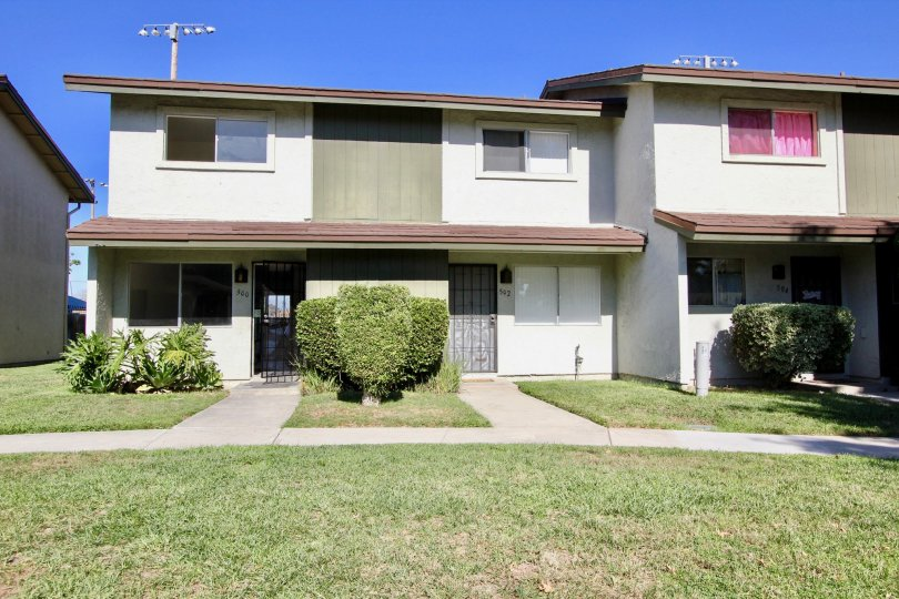 Very eco friendly home with plants and lawn of Lake Park Villas.
