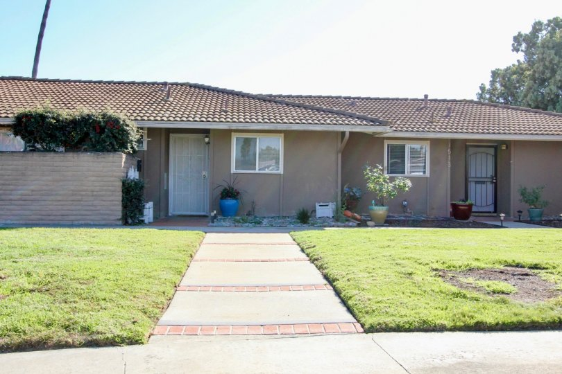 A sunny day in the area of Lake San Marcos Gardens, single family home, yard