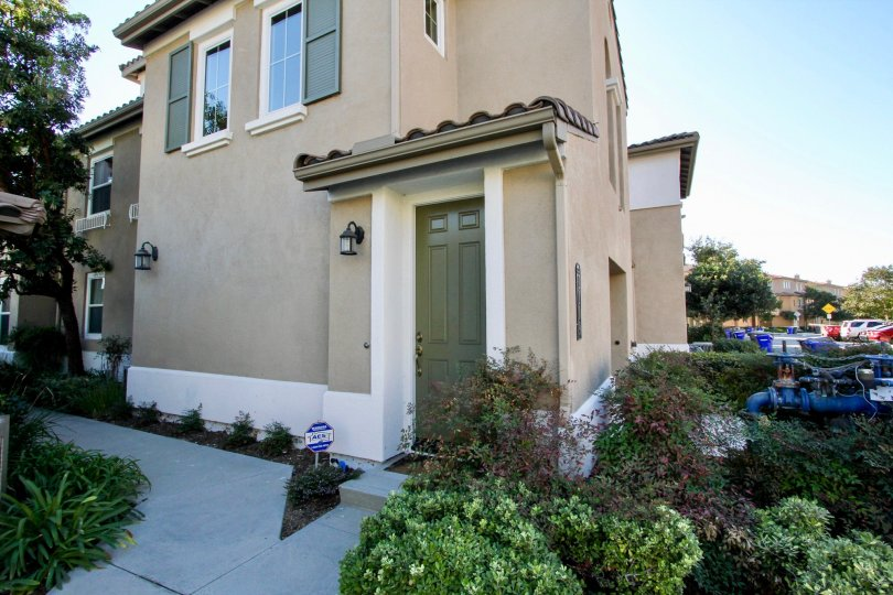 Side view with entry door of Larkspur Heights community in San Marcos, CA