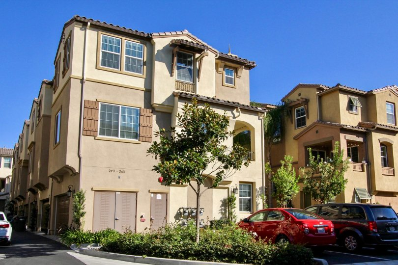 Three story residence with fake wooden shutters in Laurel at San Marcos CA