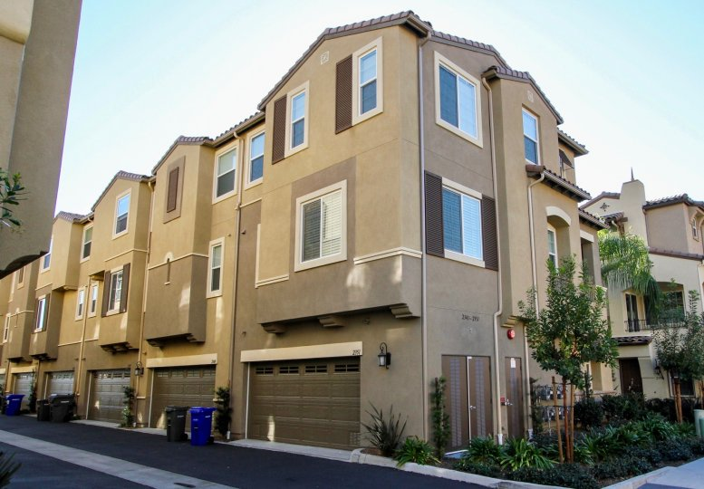 Gray garage doors on attached garages in Magnolia at San Marcos CA