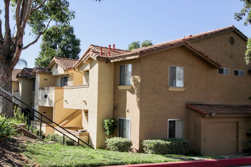 Two story housing on a lush green hillside in the Mission Park in San Marcos California
