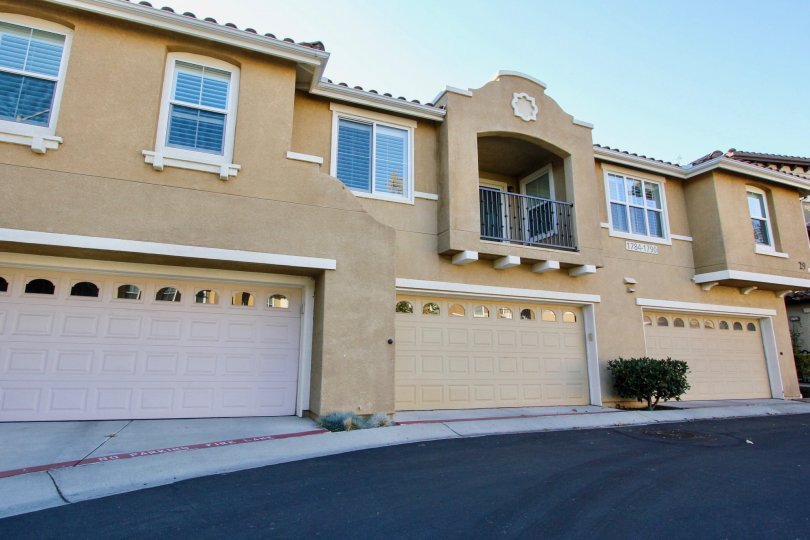 Morgans Corner beige two-story apartment condos with garage San Marcos California