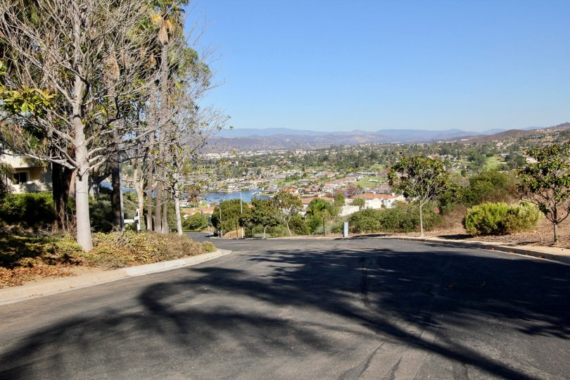 A winding road leads to a valley full of homes in the Panorama community