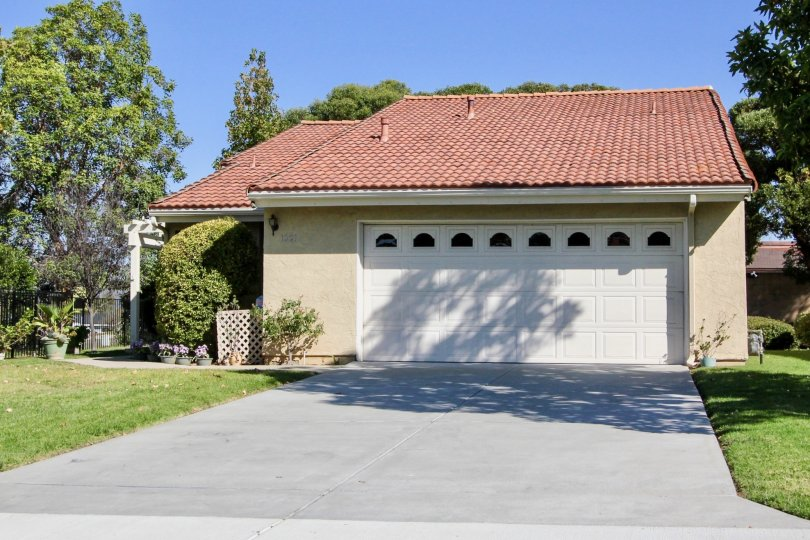 A sunny day in the area of Quail Country Villas, single family home, garage