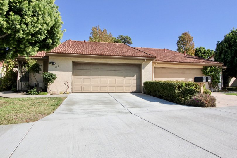 Quail Country Villas beige house with car port and garage San Marcos California