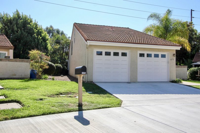 Small garage unit with two white doors inside Quail Country Villas in San Marcos CA