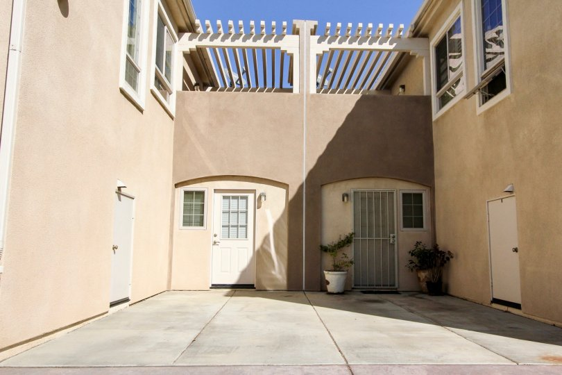 Richland Villas beige building with security doors San Marcos California