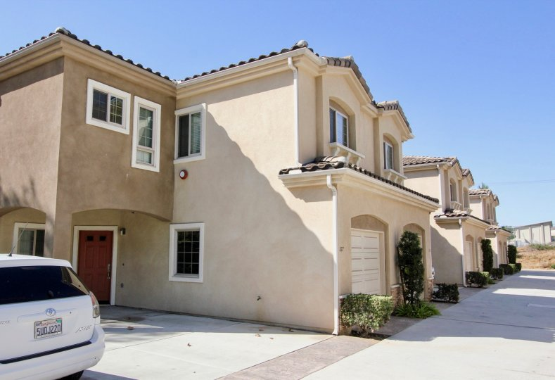 Two story brown homes with garages in the Richland Villas in San Marcos CA