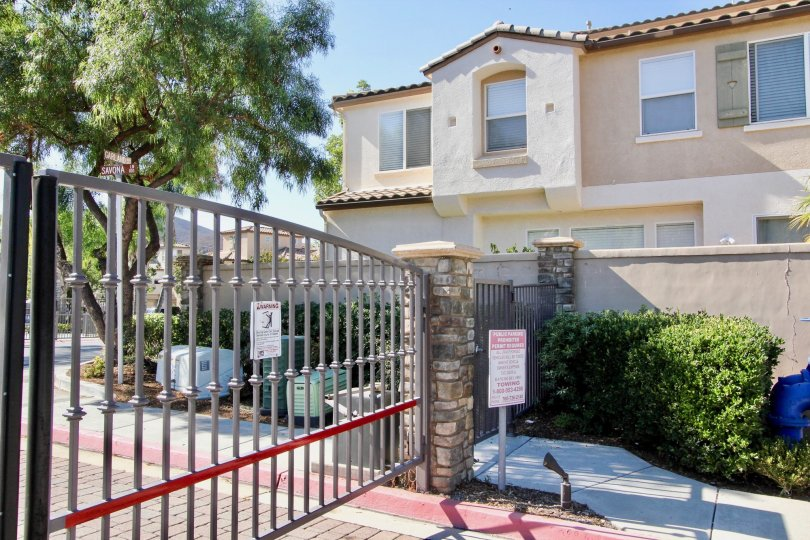 Automatic gate with a fence and building in the Savona Community in San Marcos, CA.