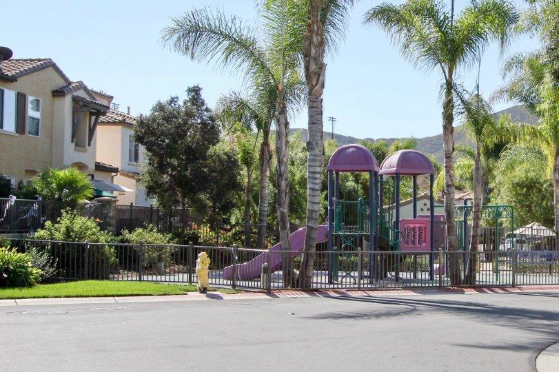 Children playground park with sliding and lawn in Savona.