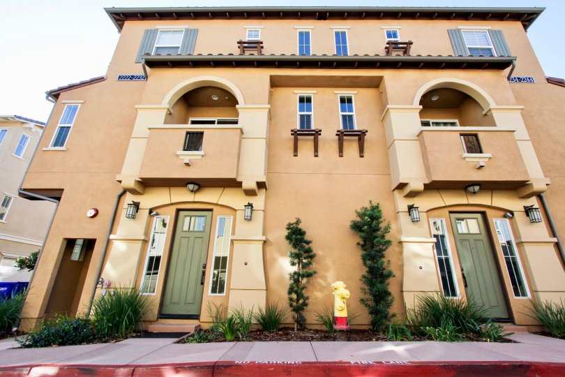 Three story building with green artistic doors in Solaire in San Marcos CA