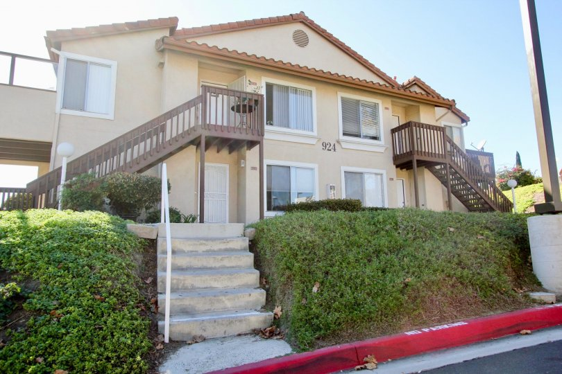 Two story brown building with steps in Sommerset By The Lake in San Marcos CA