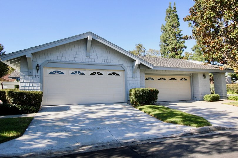 Blue home with a white garage door inside the Sunrise Points in San Marcos CA
