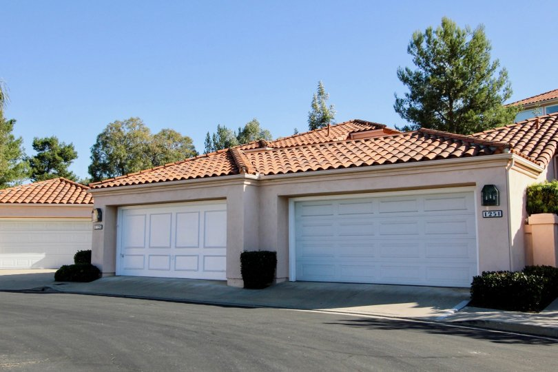The Colony beige building with white garage doors San Marcos California